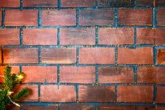 Texturera bakgrund för väggen för röd tegelsten med den prydliga filialen Arkivfoton