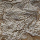 Texturera bakgrund skrynkligt brunt papper och töm utrymme för text Royaltyfria Foton