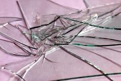 Texturera brutet exponeringsglas in i liten styckbakgrund royaltyfri bild