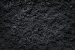 Texturera delikata naturmodeller av mörk svart kritiserar med den gråa stenen för bakgrund royaltyfria foton