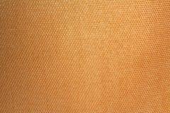 Texturera guld- tyg royaltyfria foton