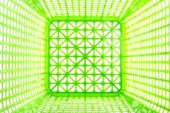 Texturera insidan av den tomma gröna plast- korgen som isoleras på vit Royaltyfri Bild