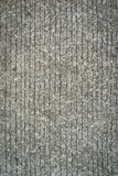 Texturera på grå färg cementerar vägen Arkivfoton
