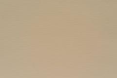 Texturera spräckligt tyg eller skyla över brister material av blek beige färg Royaltyfria Foton
