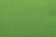 Texturera spräckligt tyg eller skyla över brister material av ljust - grön färg Royaltyfria Foton