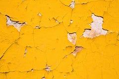 Texturerad abstrakt bakgrund av gul målarfärg Fotografering för Bildbyråer