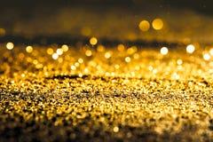 Texturerad abstrakt bakgrund blänker guld Arkivbild