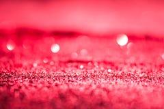 Texturerad abstrakt bakgrund blänker rosa eller rött Arkivbilder