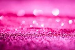 Texturerad abstrakt bakgrund blänker rosa eller rött Royaltyfri Foto