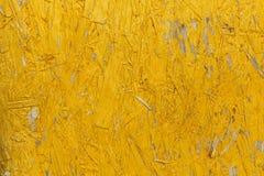 Texturerad abstrakt bakgrund i gul färg Fotografering för Bildbyråer