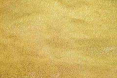 Texturerad abstrakt pappers- guld för bakgrund Royaltyfri Foto