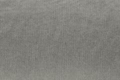 Texturerad bakgrund av blek beige färg för tyg Royaltyfria Foton