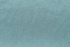 Texturerad bakgrund av blek turkosfärg för tyg Royaltyfria Bilder
