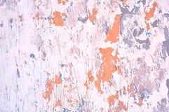 Texturerad bakgrund - skalningsmålarfärg och stuckatur på den grova yttersidan Arkivbild