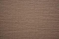 Texturerad brun bakgrund med vetical tjocka vävband arkivfoton