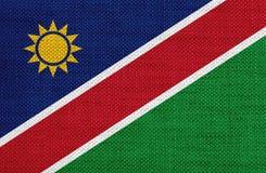 Texturerad flagga av Namibia i trevliga färger royaltyfri fotografi