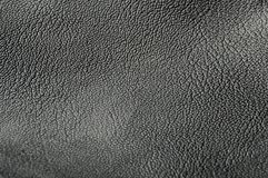 Texturerad full rambakgrund f?r svart l?der arkivfoton
