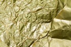 Texturerad guld- folie och bakgrund Arkivfoto