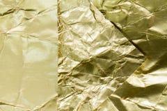 Texturerad guld- folie och bakgrund Royaltyfria Bilder