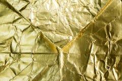 Texturerad guld- folie och bakgrund Fotografering för Bildbyråer
