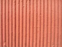 Texturerad orange murbrukvägg Royaltyfri Foto