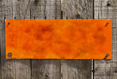 Texturerad orange rostig metallbakgrund, tom yttersida Royaltyfria Foton