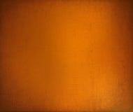 texturerad sprucken grungy orange för bakgrund Arkivfoto