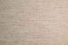 Texturerad stor beige textil för bakgrund Textur av närbilden för textiltyg royaltyfria foton
