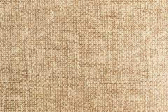 Texturerad stor beige textil för bakgrund Textur av närbilden för textiltyg arkivfoto