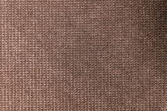 Texturerad stor brun textil f?r bakgrund Textur av n?rbilden f?r textiltyg fotografering för bildbyråer