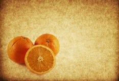 texturerad tappning för bakgrund orange papper royaltyfria bilder