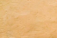 Texturerad vägg av orange färg Arkivbilder