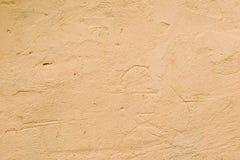 Texturerad vägg av orange färg Royaltyfri Bild