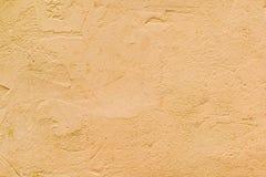 Texturerad vägg av orange färg Fotografering för Bildbyråer