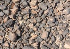 Texturerad yttersida av öknen vaggar Arkivfoto