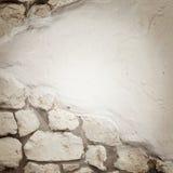 Den splittrade stenväggen texturerar Arkivfoto