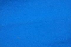 Texturerat blått tyg Arkivfoton