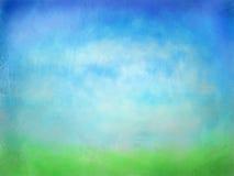 Texturerat grönt gräs med vattenfärgbakgrund för blå himmel Arkivfoto