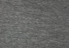 Texturerat mörkt - grått tyg för bakgrunden arkivfoto