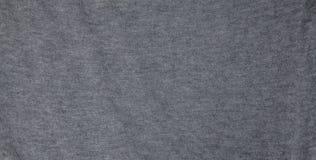 Texturerat mörkt - grått tyg för bakgrunden arkivfoton
