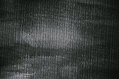 Texturerat papper i svartvitt Grå färger målad pappers- textur och bakgrund för design Closeupsikt av abstrakt begreppgrå färgtex Royaltyfri Bild