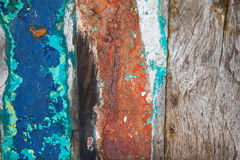 Textures background of brightly colored panels of wooden boards. Patterned and textures background of brightly colored panels of weathered painted wooden boards Royalty Free Stock Images