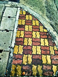 Textures and colors of the bricks on the dirty floor Stock Photos