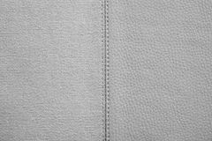 Textures of gray color from fabric and leather. The stitched combination of two textures of gray color from rough fabric and an imitation leather for abstract Stock Images