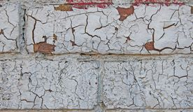 The textures of the old red brick, with cracked white paint. Close-up. The texture background of the old red brick, with cracked white paint. Close-up stock images