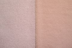 Textures of pink color from fabric and leather. The stitched combination of two textures of pink color from rough fabric and an imitation leather for abstract Stock Photos