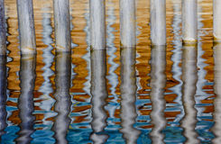 Textures of reflections in water with steel bars Royalty Free Stock Image