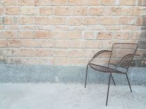 A chair in a good brick mural. royalty free stock images