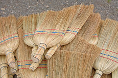 Textures of retro handmade brooms. Background of handmade brooms. Especially attractive texture give thin stalks of sorghum Stock Image