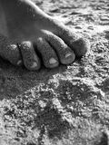 Textures of the sand. Feet in the sand, black and white Royalty Free Stock Photos